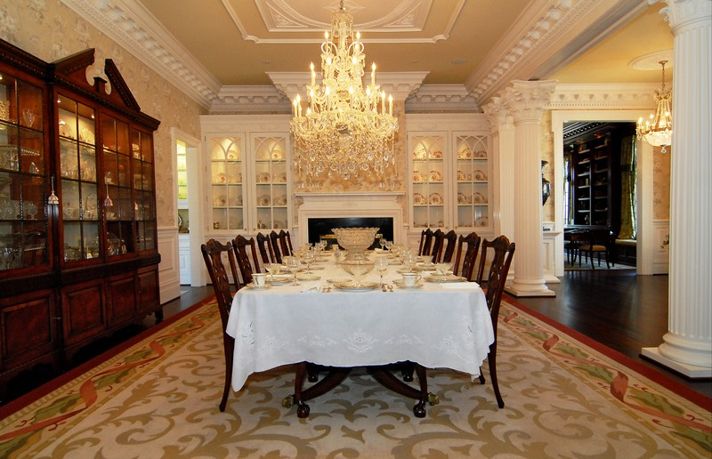 A formal dining room has an additional Waterford chandelier, which is surrounded by an ornate ceiling and a spectacular built-in butler's pantry.