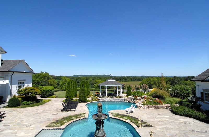 A fountain overlooks the sparkling pool....nearby a 2,000 square-foot bedroom was converted into a poolhouse.