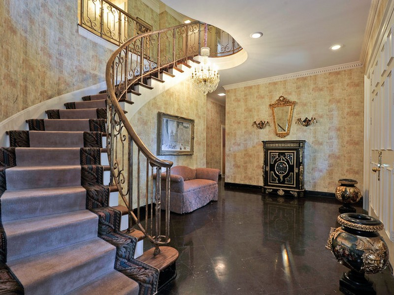 The grand curved staircase in the foyer sets the stage for this elegant estate home in Belle Meade.