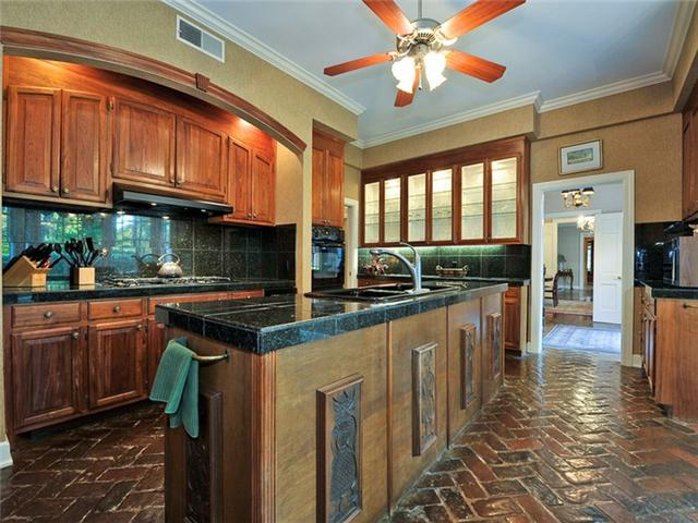 An intricate floor pattern is just one of the many interesting features in the kitchen found in this Belle Meade home for sale.
