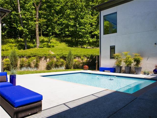 A sleek pool with straight lines mimics the architecture of this contemporary home for sale in Franklin. Offered at $1,099,000. Click on the photo for more information and additional photos from The Lipman Group Sotheby's International Realty.