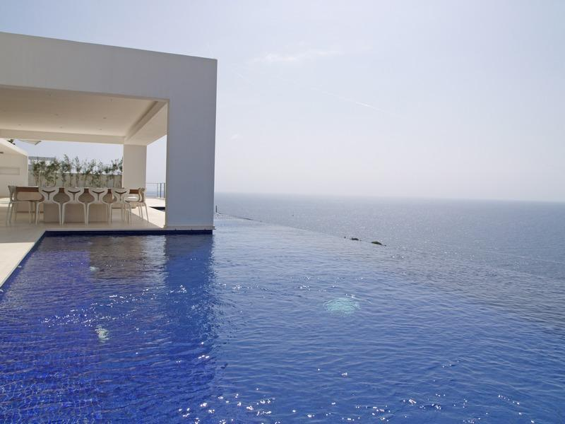 Ibiza Sotheby's International Realty in Ibiza, Spain has exquisite waterfront properties available. This spectacular minimalist villa faces southeast and offers  the most incredible unobstructed sea views from every room. Offered at $6,406,108 USD. Click on the image for more photos and information from sothebysrealty.com.