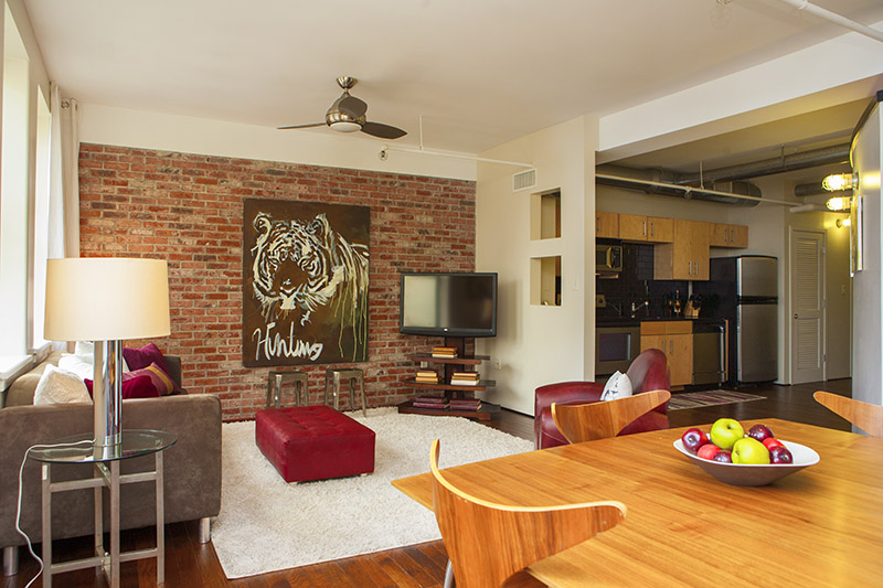 Located in the Bennie Dillon building in Downtown Nashville, which is listed on the National Register of Historic Places, this downtown loft has new, gorgeous hardwoods throughout with heated marble flooring in the bath, exposed brick walls, stainless steel appliances, granite countertops & incredible views. The largest 1 bedroom floor plan in the building!
