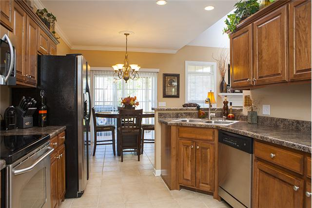 Wonderful home for sale in mount juliet for Dark brown kitchen cabinets with stainless steel appliances