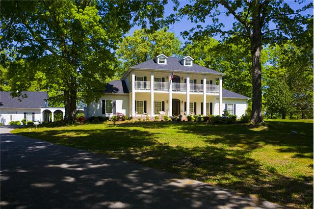 This beautiful plantation home sits on over 23 acres in Dickson, TN with the opportunity to purchase additional acreage. The property also features two separate guest houses and beautiful grounds. Click on the image for more photos and information from The Lipman Group Sotheby's International Realty.